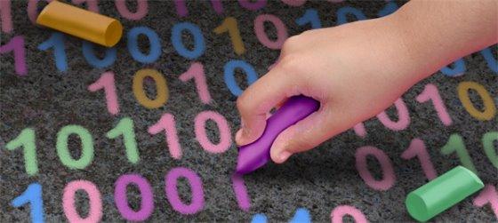 child's hand writing binary code in chalk