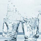 thumbnail--two water glasses clinking and spilling water