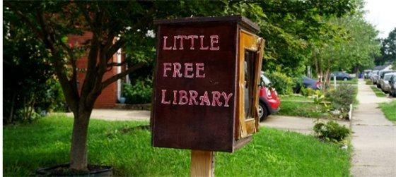Little Free Library installed near a sidewalk