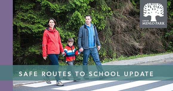Safe Routes to School Update - mother and father walk son through crosswalk