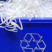 paper shredded in blue recycling bin