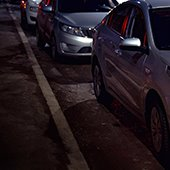cars parked on street at night
