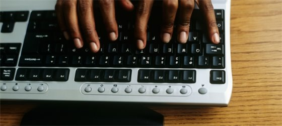 African american hands typing on keyboard: we want your feedback - online suggestion box