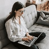 woman teleworking from the couch at home