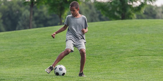 african-american-youth-solo-kicking-soccer-ball