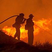 firefighters battle wildfire