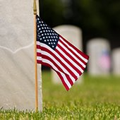 Memorial Day U.S. flag by headstones