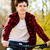 Male teen riding bicycle