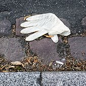glove thrown on the street