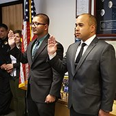 Officers Kumar and Sammut take their oath
