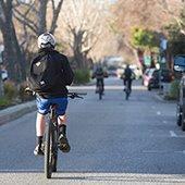 students ride bicycles on Santa Cruz Avenue