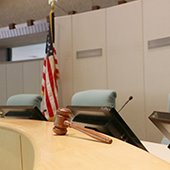 city council chambers with gavel and flag on dais