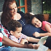 Family-enjoys-entertainment-on-a-table-device