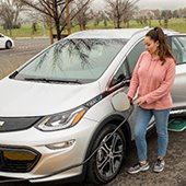 Woman-charging-her-plug-in-electric-car