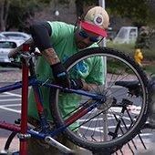 4 -Thumbnail--Man-repairing-a-bicycle