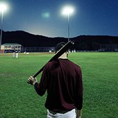 softball player at night game