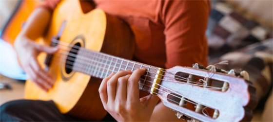 close up of a guitar being played