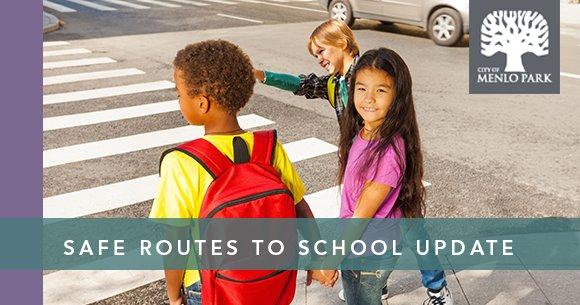 Children crossing street at a crosswalk