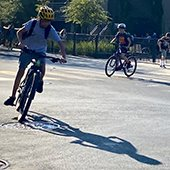 student riding a bicycle in the street