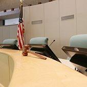 city council dais flag gavel monitors