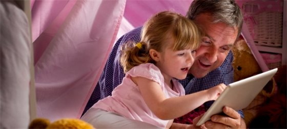 man and child reading in a play tent