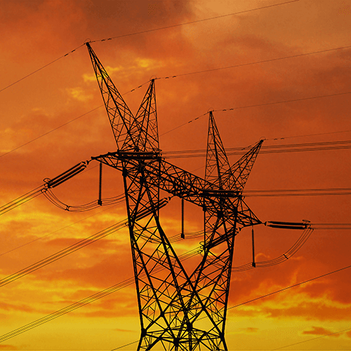 electric-transmission-line-and-tower-at-sunset
