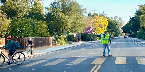 Blog--Crossing-guard-holding-stop-sign-in-crosswalk