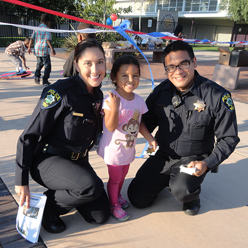 national night out block party officers with child