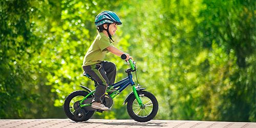 Blog--young-boy-wears-helmet-riding-bicycle-with-training-wheels