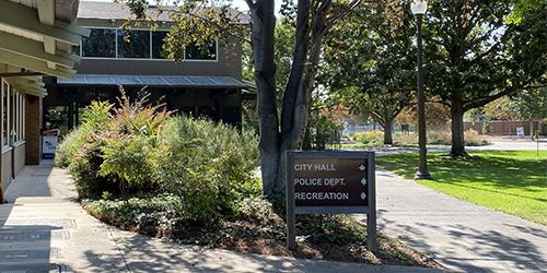 Blog--directional-sign-in-front-of-Police-Department-and-City-Hall