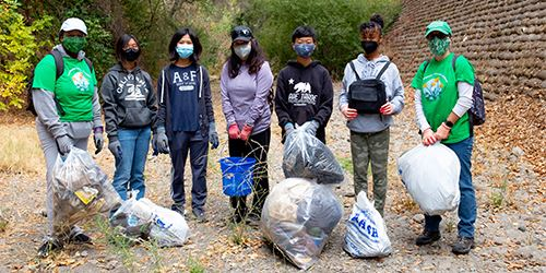 Blog--San-Francisquito-Creek-Cleanup-volunteers-with-bags-of-trash-collected