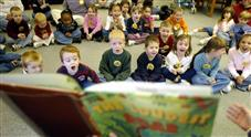 Group of children listening to a book